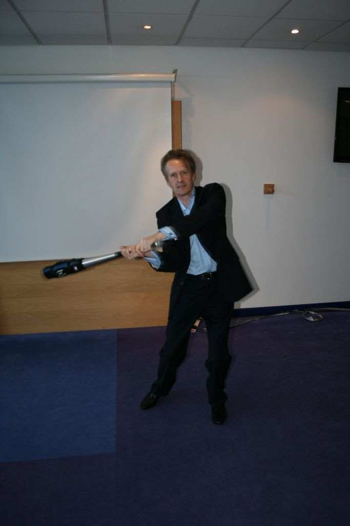 Phil demonstrates perceptual contrast with a baseball bat